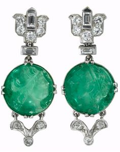 Art Deco platinum, carved emerald and diamond earrings attributed to mauboussin, ca. 1928 Platinum and diamond lotus blossom motif link followed by round carved emerald cameo, prong set diamond accented 'V' shaped link to finish.