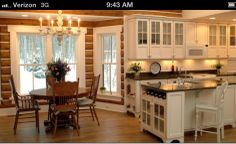 Love the bright cabinets and the doors with a partial glass.