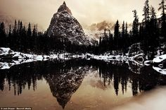Lone Eagle Peak Mountain where the trees reflect off the water in the Indian Peaks Wilderness area of Colorado.