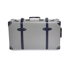 """Char-blue Gunclub 30"""" Globe-Trotter Case. Made exclusively for The Merchant Fox by Globe-Trotter, makers of the world's most luxurious and iconic suitcases, this practical and stylish 30"""" extra deep suitcase with wheels has a grey body with navy blue leather trim and straps and is finished with chrome fittings. The spacious interior is lined with a Fox Brothers char blue gunclub check flannel. British Traditions, Timeless Design, 30th, Flannel, Globe, Chrome, Fox, Old Things"""