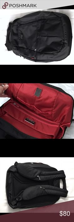 Tumi Backpack Awesome high tech Tumi backpack. Exterior is black with dark grey side panels. Inside is red. Condition is 9/10. Amazing quality bag! Tumi Bags Backpacks