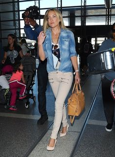 Actress and busy mom Kate Hudson departing on a flight at LAX airport in Los Angeles, Calfiornia on April 10, 2015. Rumors are swirling that Kate and 'Dancing With The Stars' favorite Derek Hough are currently dating!