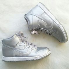 Nike Silver Metallic Sparkle High Dunk Sneakers Your favorite basketball look just got better with the updated Nike Dunk High Women's Shoe!  Designed for high performance and low environmental impact. Durable leather upper, eva midsole, solid rubber outsole for traction and durability Condition: Excellent- Lightly worn. Nike insole logo has started to peel away, some tiny scuffs, & some minimal stains on white part of sneakers. These were only worn a few times and in almost new condition…