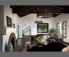 A collection of California art and design pieces, with a 1912 painting by William Ritschel // Diane Keaton's living room in, designed by Diane Keaton and Steohen Shadley | Architectural Digest