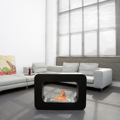 Orlando // Black - The Orlando is a mod mobile fireplace that works on your living room floor or elevated for drama in your environment. The Orlando's bio-ethanol flame is dirt-free for a clean, contemporary look that changes up your decor.