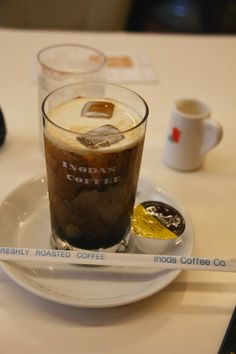 Inoda Coffee -  run a popular chain of cafes in Kyoto town.  They  have done since 1940. If you can deal with the smoke you will have a decent, old school, coffee experience.