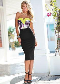 Colorful bust, solid black bottom = the perfect midi dress. Venus neon print midi dress.