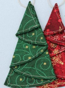 Tiny Tree Ornament Tutorial - can make as cloth napkins - cut circle, hem, iron in half then iron like picture. -Awesome!
