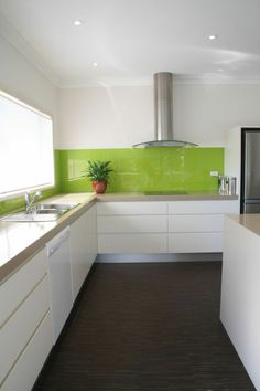 This zesty lime green kitchen splashback is a welcome contrast to the otherwise monochrome design - and it looks easy-to-clean, too! Kitchen Inspirations, Green Kitchen Decor, Small Kitchen, Kitchen Remodel, Kitchen Decor, Kitchen Backsplash, New Kitchen, Home Kitchens, Modern Kitchen Design