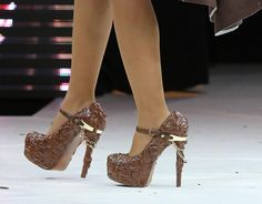 shoes made with chocolate during a fashion show at the inauguration of the 19th annual Salon du Chocolat in Paris on October 29, 2013