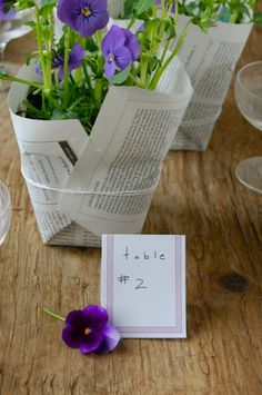 DIY: Newspaper Wrapped Plants  I'd use sheet music