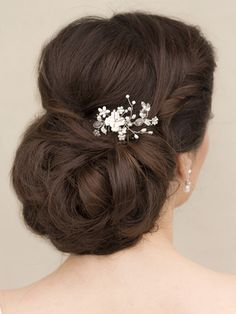 Small porcelain ceramic type flower bridal hair comb accented with rhinestones and freshwater pearls by Hair Comes the Bride.