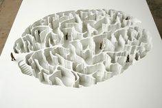 The image of a Brain was carved in a volume of PVC, creating a design of maze. The sculpture functions like a model for a public art project.