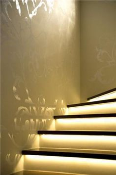 stencil with glossy paint on matte paint of the same color! Also lighting on the stairs.