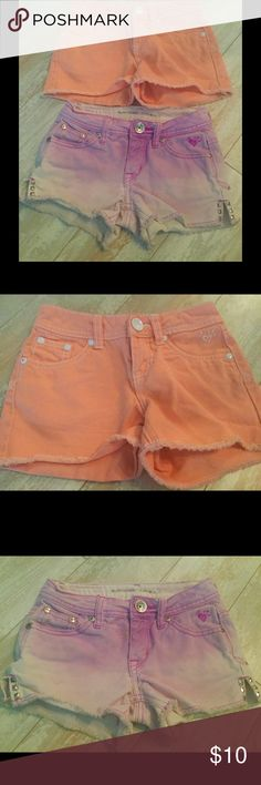 JUSTICE Girls Denim shorts Peach & Purple Sz 7/8 JUSTICE Girls Denim shorts. Peach and purple. Lightly used, excellent condition. Peach pair like new, Sz 7R. Purple pair has silver studs on sides bottoms for cute detail, excellent condition, Sz 8S. Smoke free home. Justice Bottoms Shorts