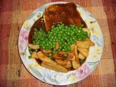 Canadian Hot Hamburg Sandwich with brown gravy, steak fries and peas.