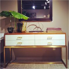 love the console table white lacquer gold hardware