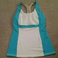 LULULEMON workout top Fits a small/med and in perfect condition from smoke free and pet free home. Has no padding but does have a bra lining. lululemon athletica Tops