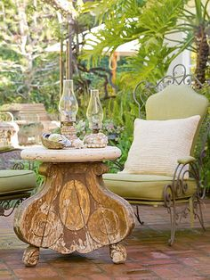 Salvaged Style:   An antique pedestal with a concrete top becomes a unique outdoor cocktail table. Outdoor fabric that's durable and weather-resistant dresses up the patio furniture and allows the homeowners to furnish the space similar to an indoor room -- with throw pillows and colorful upholstery.