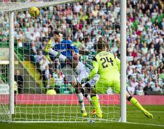 Joe Garner nods in Rangers' goal, but he has been unable to halt Celtic increasing their lead in the second half