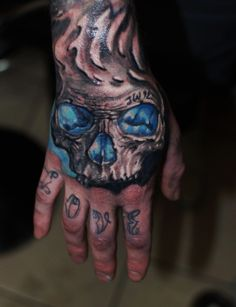 """""""Skull"""" incredible looking colour work on the hand from Ivan Bor at hammersmi. - """"Skull"""" incredible looking colour work on the hand from Ivan Bor at hammersmith tattoo! Skull Hand Tattoo, Skull Sleeve Tattoos, Hand Tats, Hand Tattoos For Guys, Skull Tattoo Design, Tattoo Designs, Knuckle Tattoos, Forearm Tattoos, Body Art Tattoos"""