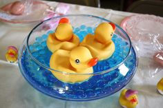 Centerpieces for baby shower: terrarium vases, blue water pearls, and rubber duckies--so cute!
