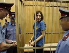 Nadezhda Tolokonnikova, a member of female punk band, Pussy Riot, stands behind bars during a court hearing in Moscow. Three members of the all-woman punk ban were detained after they stormed into Moscow's main cathedral to sing a protest song against Vladimir Putin and criticised the Russian Orthodox Church's support for him. (© Reuters)