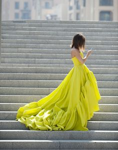 Is she texting? Maybe meeting a friend for coffee in this dazzling designer piece.