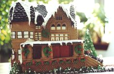 This one looks more like a house than gingerbread. Its by Edible Art and I love the nostalgic feel of the photo.