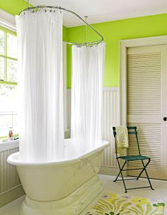 Soaker Tub :: LOVE. Not a huge fan of the lime green, but it's not bad with all that natural light! The space does feel light and fresh, though.