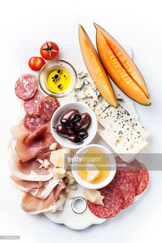 Stock Photo : Antipasti ham, cheese, melon, olive oil with balsamic