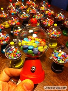 Gumball machine made from clear ornament and mini flower pot