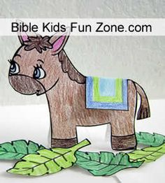 Standup Donkey craft for preschoolers to make with palm branches and coat to fold over its back.