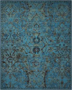 TML02 Timeless Peacock - Shimmering like peacock feathers with an almost magical iridescence, this remarkable carpet is based on a 17th century ''Polish'' design made at the Persian court manufactory of Kashan. Its hexagonal middle panel enclosed by arabesques was executed in twelve colors with a general light tone. While faded by time, its beauty is the inspiration for this resplendent carpet which presents a luxurious field of blues ranging from indigo to lapis.