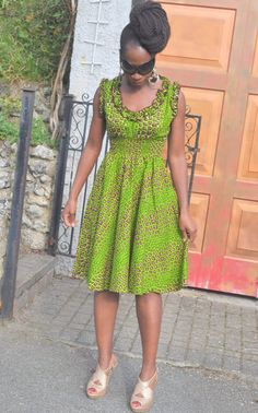 Green dress with ruffles at the sleeves and neckline.