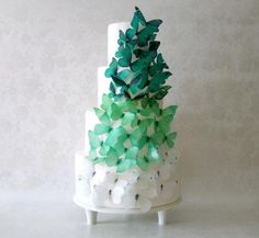 Achieve a breathtaking wedding cake with an artful arrangement of edible ombré butterflies. #etsyweddings