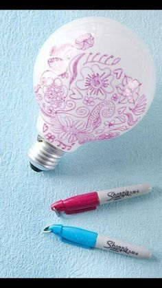 Draw designs on a lightbulb to create designs on the wall when you turn it on!