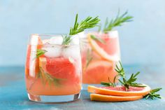 grapefruit and rosemary gin cocktail refreshing drink with ice