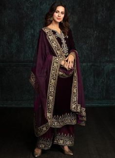 Deep Plum and Wine Velvet Palazzo Suit features a velvet kameez with santoon inner, dhupioni silk palazzo pants and net dupatta. Embroidery work is completed with zari, sequins and stone work embellishments. Velvet Pakistani Dress, Pakistani Formal Dresses, Pakistani Dress Design, Pakistani Outfits, Indian Dresses, Indian Bridal Fashion, Indian Wedding Outfits, Indian Outfits, Velvet Suit Design