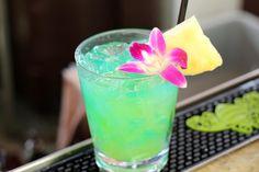 Edgy Blue Hawaii~fill glass with ice, put Blue Curacao, light rum, vodka, lemonade & pineapple juice