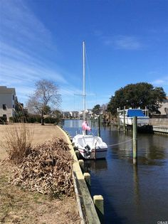 214 Outrigger Drive Kill Devil Hills, NC 27948 List Price: $124,900 Great Lot on the Canal in Collington Harbor. Call Beth Twyne at 252-473-4272 at Carolina Dunes Real Estate www.carolinadunesrealestate.coom