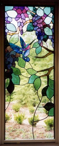 Hummingbirds and Wisteria (Left Panel).