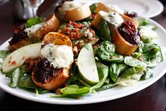 Spinach salad with apples, pecans, blue cheese and crostini w/ red onion jam