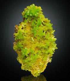"Bright apple green glassy sharp pyromorphite crystals to 1/2"" on matrix; Daoping Mine, Guangxi, China."