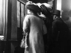 Titanic passengers' families read lists of survivors posted inside the White Star Line's London office.