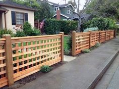 Here's a beautiful cedar lattice front lawn fence. Here's a beautiful cedar lattice front lawn fence