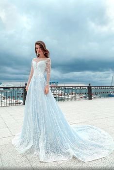 Model: BR-025 Available colors: White / Ivory Sleeve length: Long sleeve Train length: without train Back: Covered back Lace: With shine/ Without shine Neckline: deep V  If you would love to make some modifications, we are open to do it ❤️ Soft Wedding Dresses, Light Blue Wedding Dress, Colored Wedding Dresses, Perfect Wedding Dress, Bridal Dresses, Burgundy Wedding, Wedding Colors, Gown Wedding, Light Blue Dresses