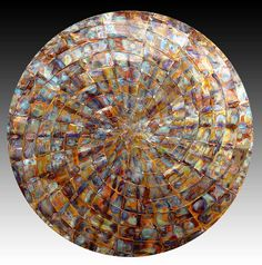 """Woven Spiral Circle, 48"""" diameter, flame colors on copper"""