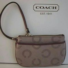 Coach Signature Dot Op Art Small Wristlet NWT Good Things Do Come In Small Packages, Especially When It's This Coach Signature Dot Op Art Wristlet! NWT, Khaki & Berry Purple Colored Small Wristlet In Jacquard With Maroon Colored Leather Trim. Silver Fittings, Zipper Top, Grey Linen Fabric Lining & An Open Outside Pocket. There's Also A Strap With Clip To Form A Wrist Strap Or Alternately Attach The Strap To Inside Of Bag. Coach Bags Clutches & Wristlets