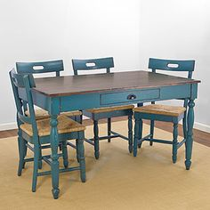 Camille Dining Collection    $219.98 to $299.99    Whether your look is American vintage, French country or pure eclectic, the Camille Dining Collection adds instant credibility to any interior. In a distressed peacock blue finish, this collection offers a simple aesthetic that never fades from style. Made of pine, acacia and woven seagrass, it's the very essence of farmhouse chic.